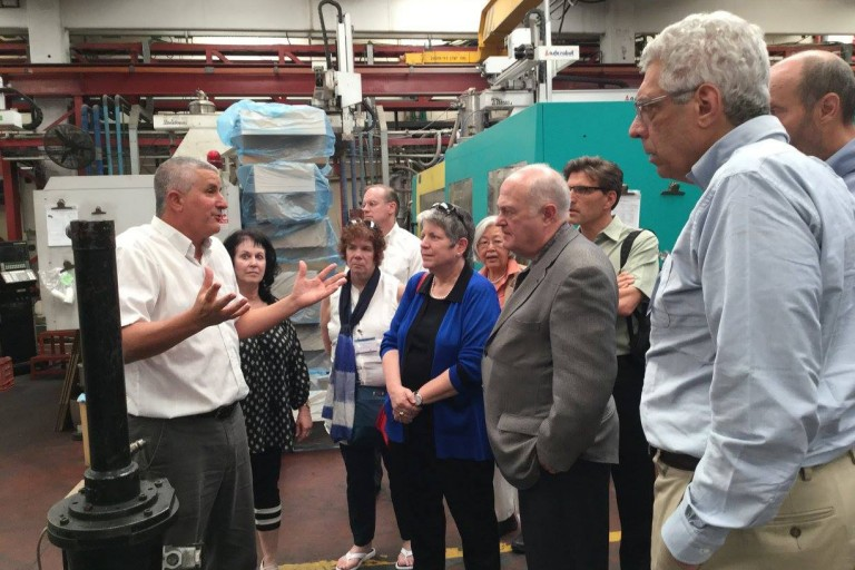 Group of University Alumni visiting a manufacturing plant