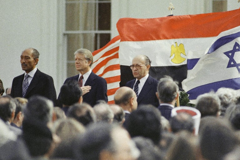 Photo of Carter, Sadat and Begin celebrating Egypt Israel Treaty