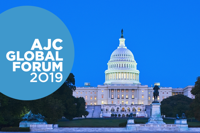Photo of U.S. Capitol at night with AJC Global Forum 2019 text