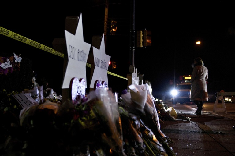 A woman walks past a makeshift memorial outside the Tree of Life Congregation October 30, 2018 in Pittsburgh, Pennsylvania. -
