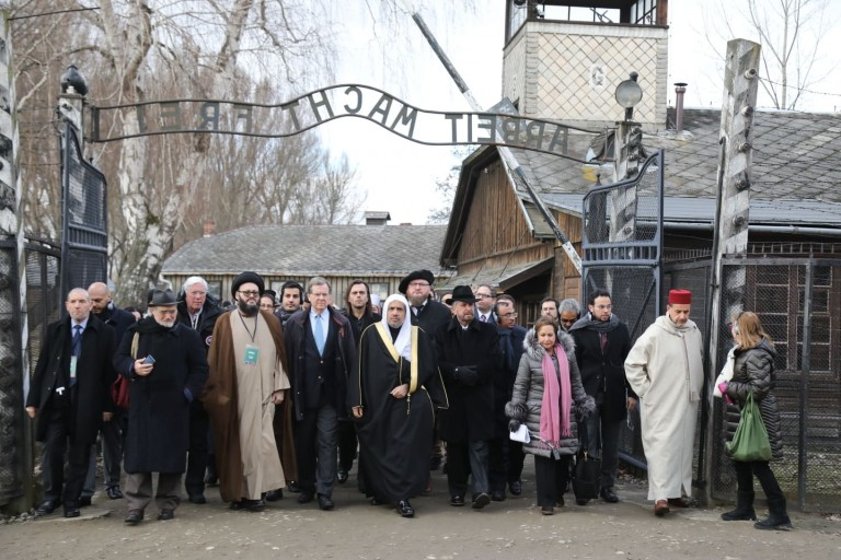 "American Jewish Committee and Muslim World League Historic walking through the ""Arbeit Macht Frei"" gate at Auschwitz"