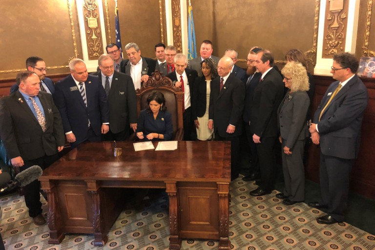 Photo of Governor Noem signing BDS legislation.