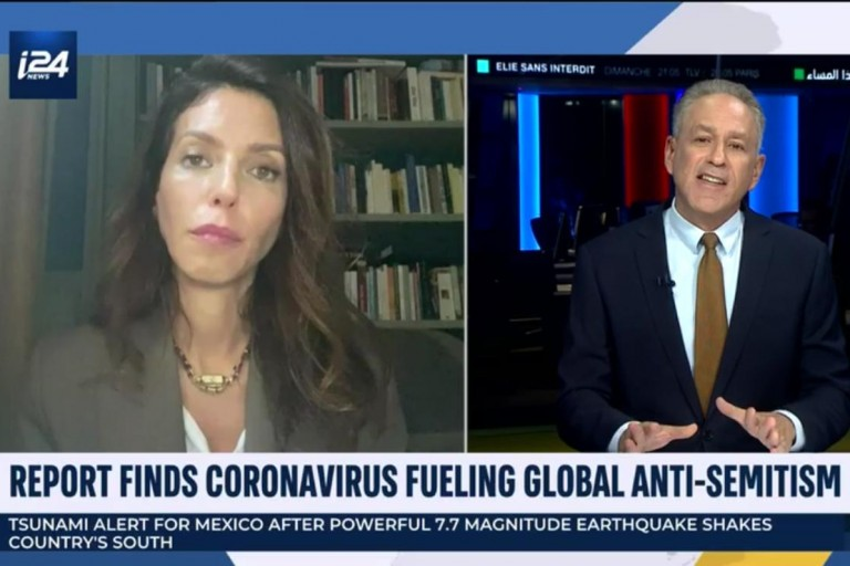 Photo of Simone Rodan on i24 with the host speaking on a report which finds coronavirus fueling global antisemitism