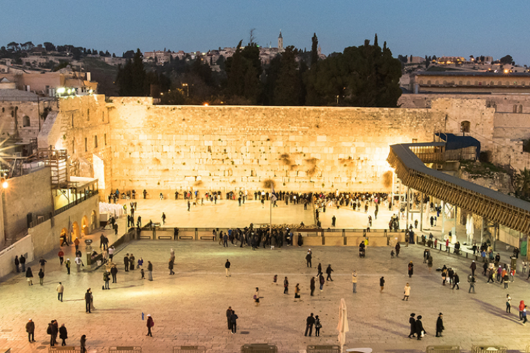Photo of the Western Wall at dusk