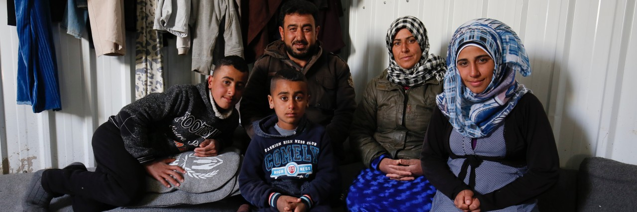 Photo of a Syrian refugee family in the Azraq camp in northern Jordan