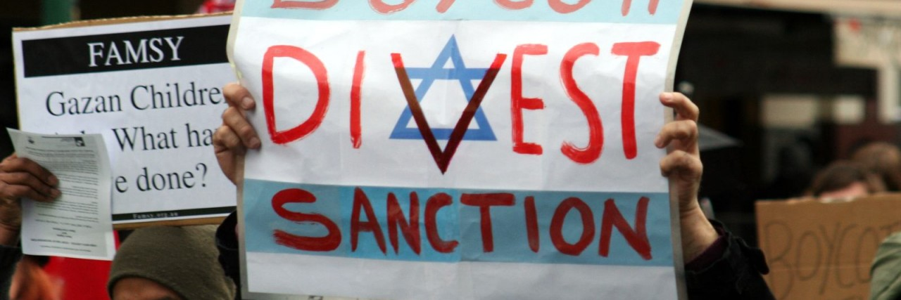 Photo of a Boycott Divest Sanction sign at a BDS protest