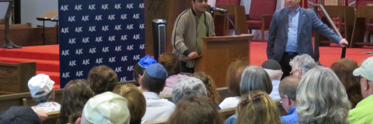 Photo of Mohammed Al Samawi speaking at AJC Seattle event