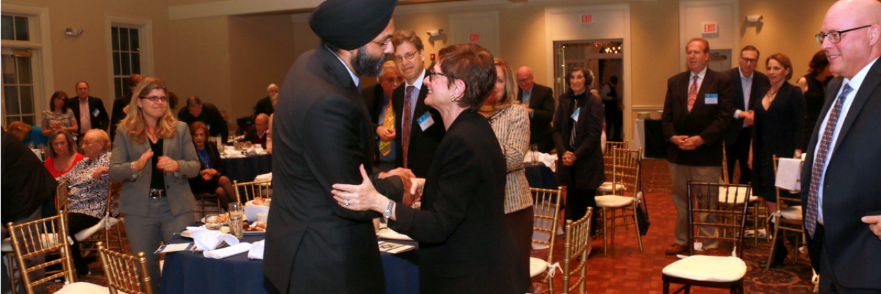 AG Grewal shaking hands with AJC Metro New Jersey's Board President, Genesia Perlmutter Kamen at AJC New Jersey Metro Annual Meeting and Dinner