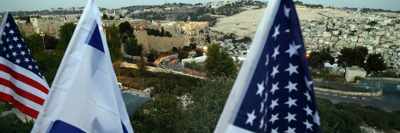 Photo of Israeli and American flags over the Old City, Jerusalem