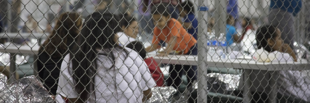 Photo of children in separation detention facility cages