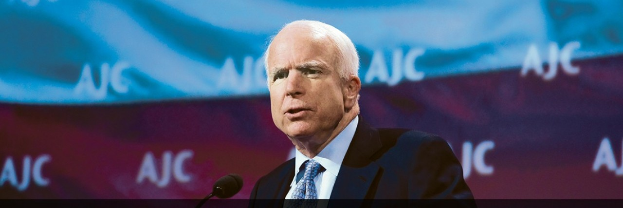 Photo of Senator John McCain speaking at AJC Global Forum