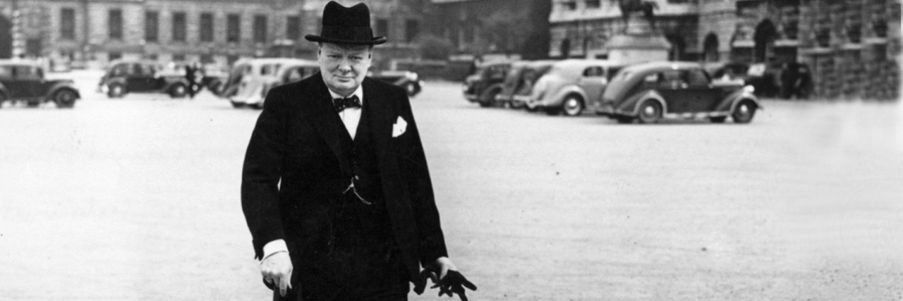 Winston Churchill walking on a street