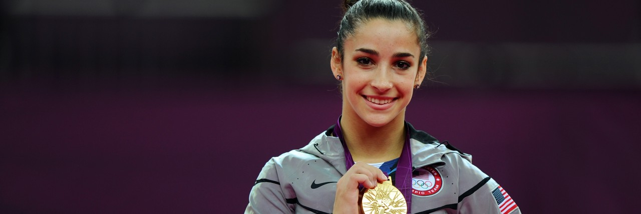 Gold medalist Ally Raisman poses on the podium during the medal ceremony for the Artistic Gymnastics Women's Floor Exercise final on Day 11 of the London 2012 Olympic Games at North Greenwich Arena.