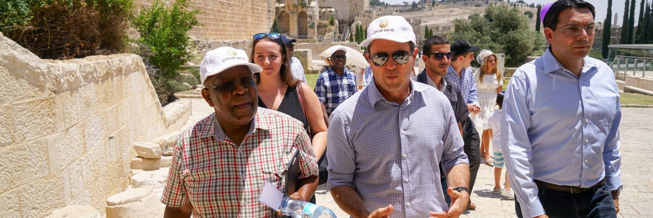 Photo of UN Ambassadors walking through the Old City.