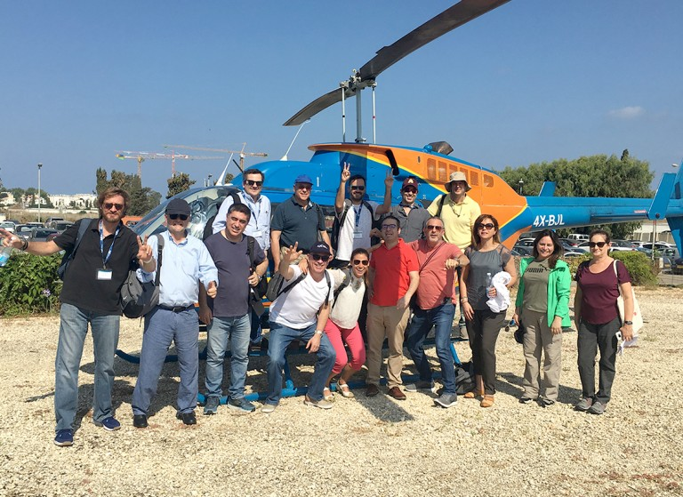 Delegation getting ready to take a helicopter ride.