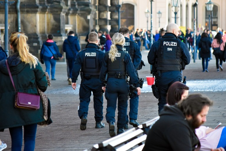 Photo of the backs of four German polizei