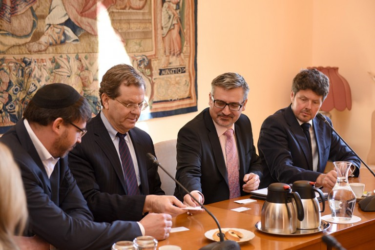 Photo of David Harris leading an AJC delegation in a meeting with Czech Deputy Foreign Minister Václav Kolaja