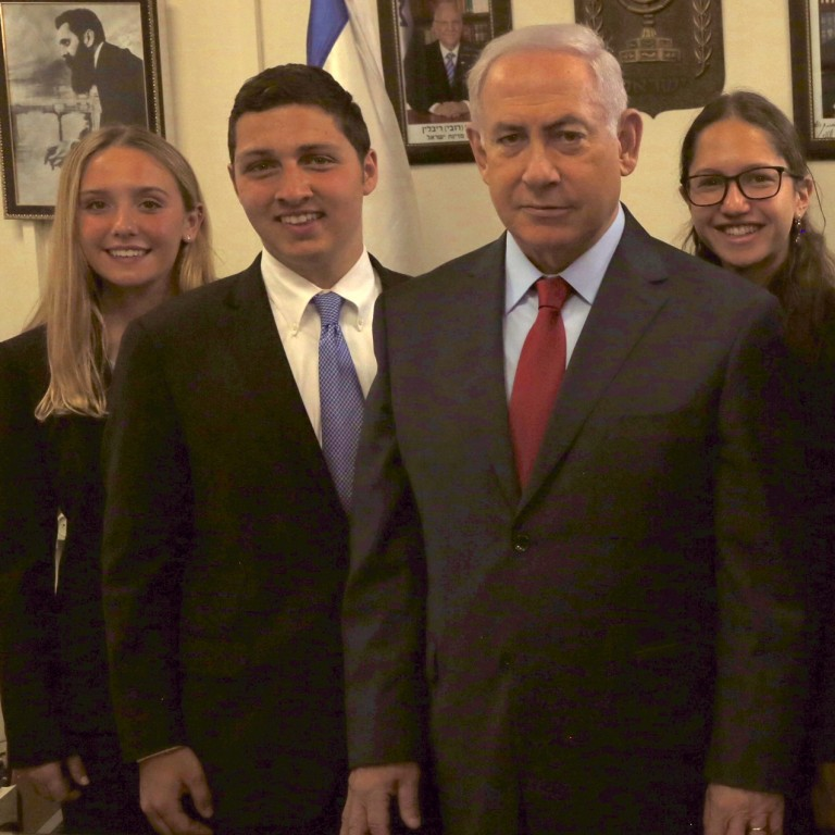 Photo of members of the founding class of LFT students with Prime Minister Netanyahu