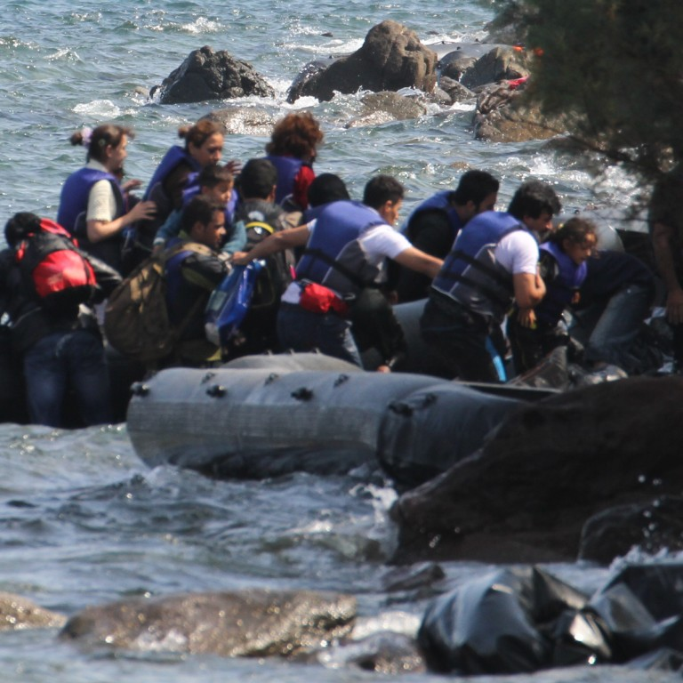 Photo of Syrian Refugees on inflatable boats