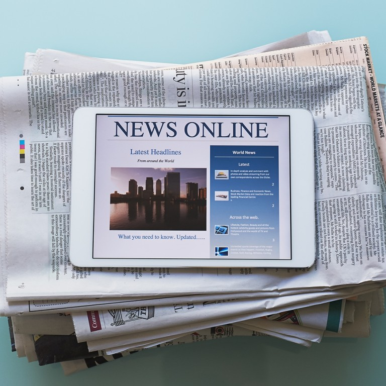 Photo of a stack of newspapers and an iPad displaying - News Online