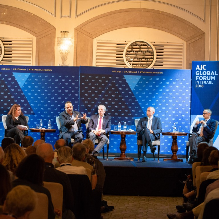 Photo of a panel of three leading officials from the EU, UN, and Israel, moderated by Melanie Maron Pell at AJC Global Forum 2018