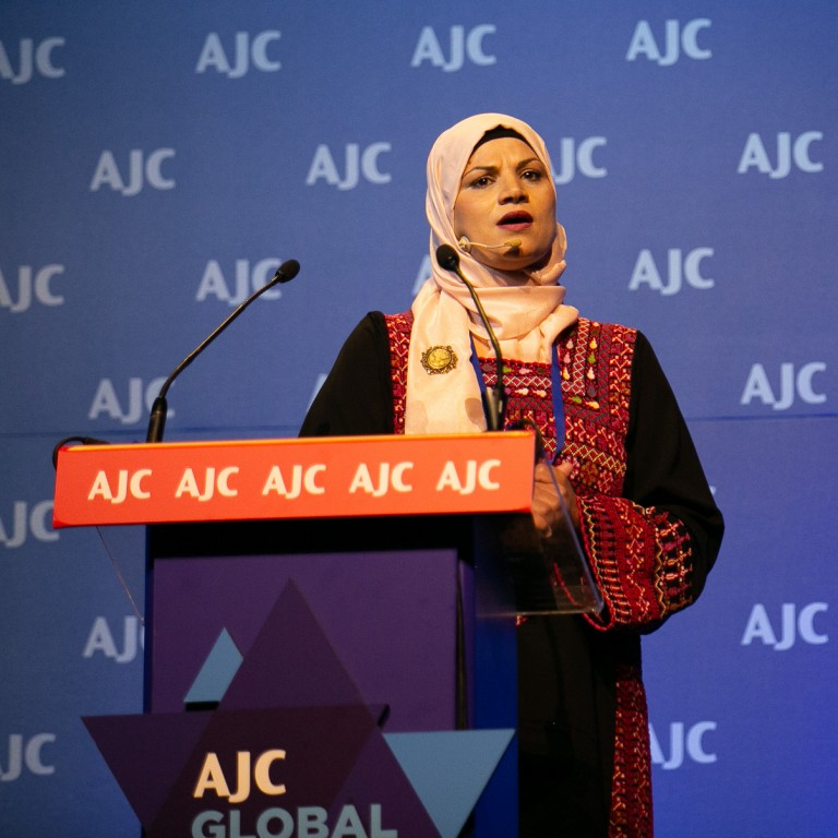 Photo of Ahlam Alsana speaking at AJC Global Forum 2018