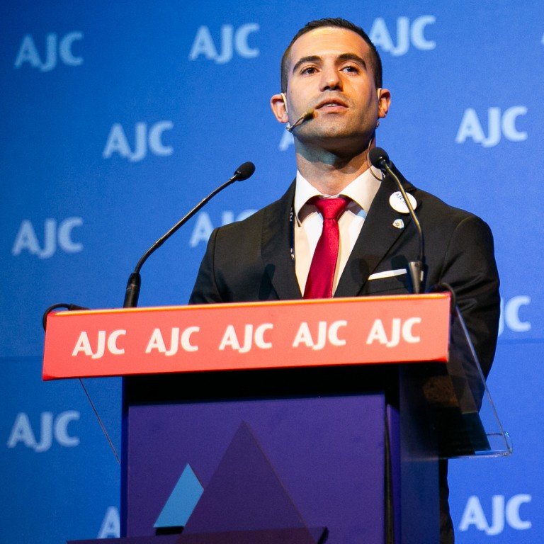 Photo of Ahmed Zoabi speaking at AJC Global Forum 2018