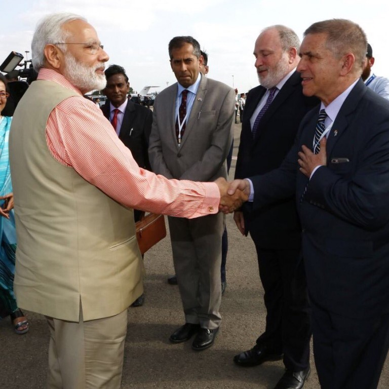 Photo of Indian Prime Minister Modi shaking hands with Israeli Ambassador Carmon