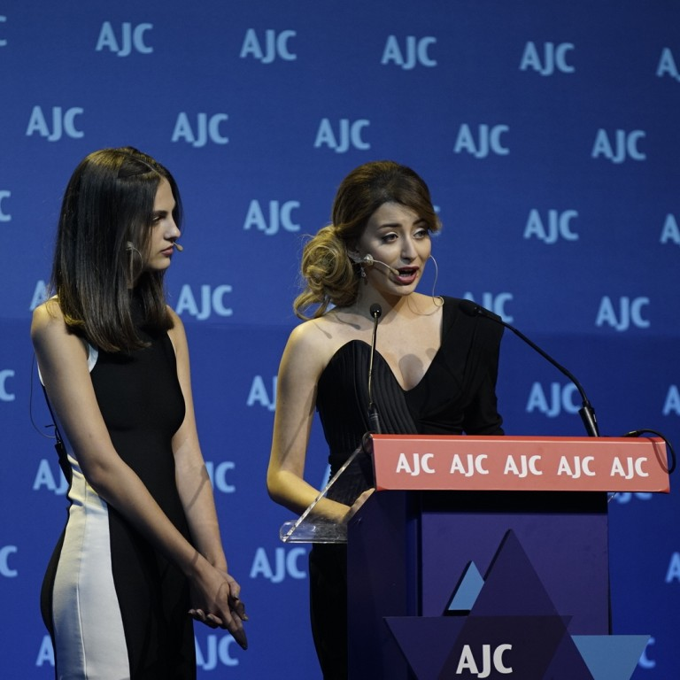 Photo of Ms. Iraq addressing AJC Global Forum 2018