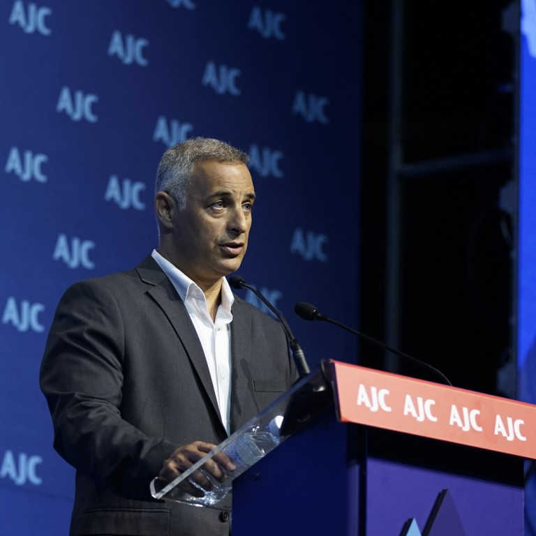 Photo of Dr. Eyal Sela accepting the AJC Moral Courage Award at AJC Global Forum 2018