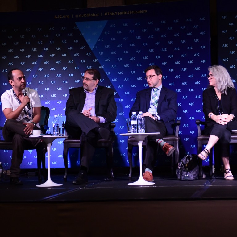 Photo of a panel of 4 experts, moderated by Yoav Limor, at AJC Global Forum 2018