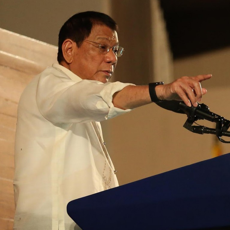 Philippine President Duterte speaks at an event in front of the podium.