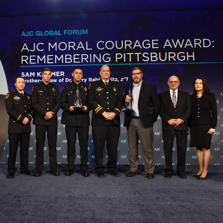 Photo of Pittsburgh First Responders accepting AJC Moral Courage Award at AJC Global Forum 2019