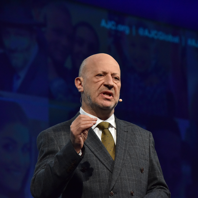 Photo of Edwin Shuker addressing AJC Global Forum 2019