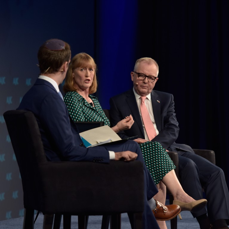 Photo of Seffi Kogen interviewing two members of British Parliament, Joan Ryan and Ian Austin, at AJC Global Forum 2019