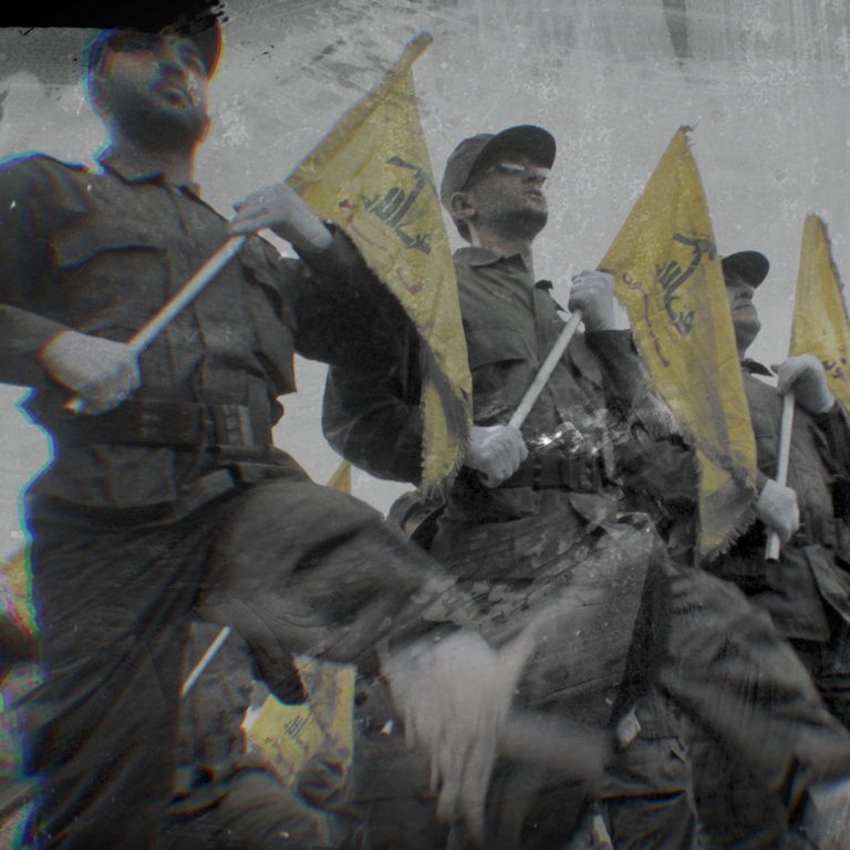 photo of Hezbollah militants marching with flags