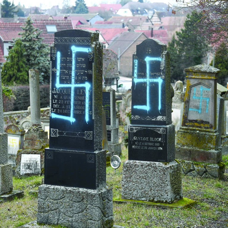 Photo of a cemetery in France with blue graffiti