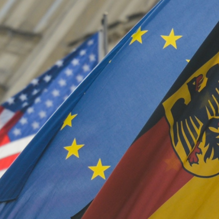 American, EU, and German flags
