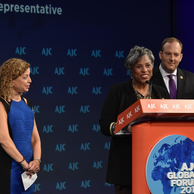 Photo of Rep. Brenda Lawrence addressing AJC Global Forum 2019 with Reps. Debbie Wasserman-Schultz and Lee Zeldin.