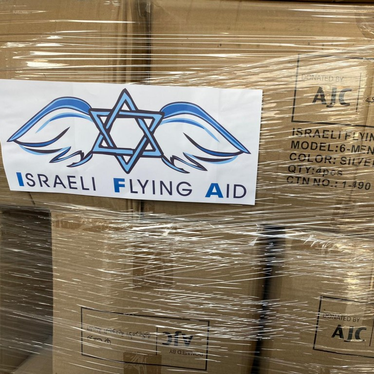 Israel Flying Aid text on boxes with AJC on them