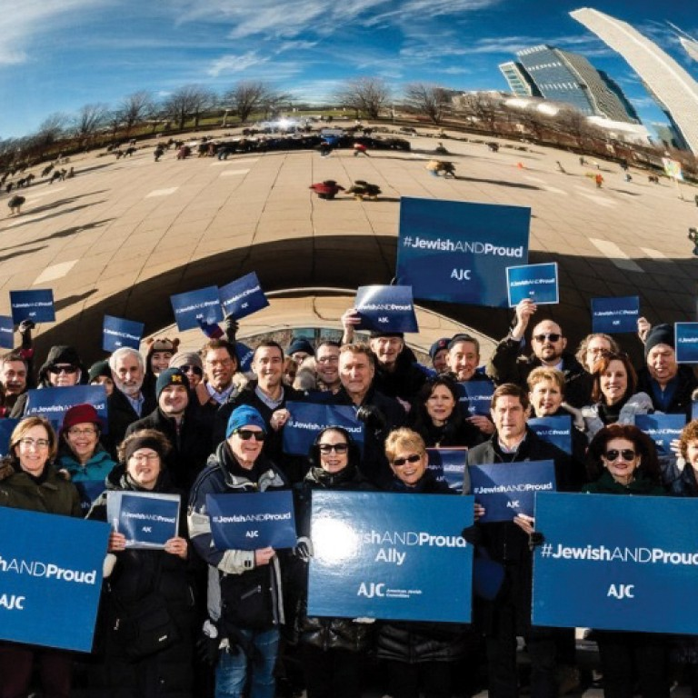 Members of Chicago's Jewish community gather at Chicago's Millenium Park to mark AJC's #JewishandProud Day.