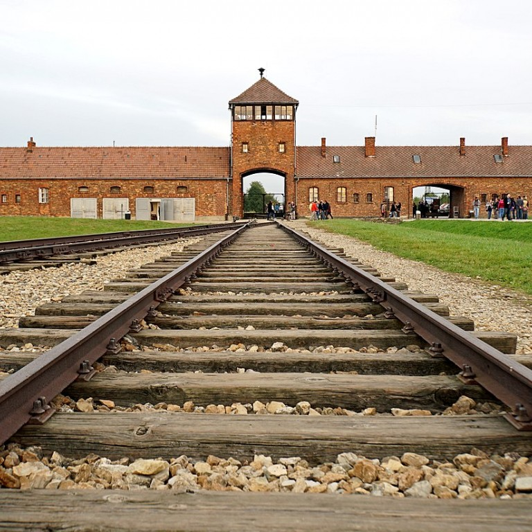 Photo of train tracks leading to Auschwitz, Poland