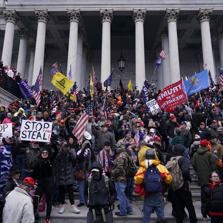 Rioters gather at the U.S. Capitol Building