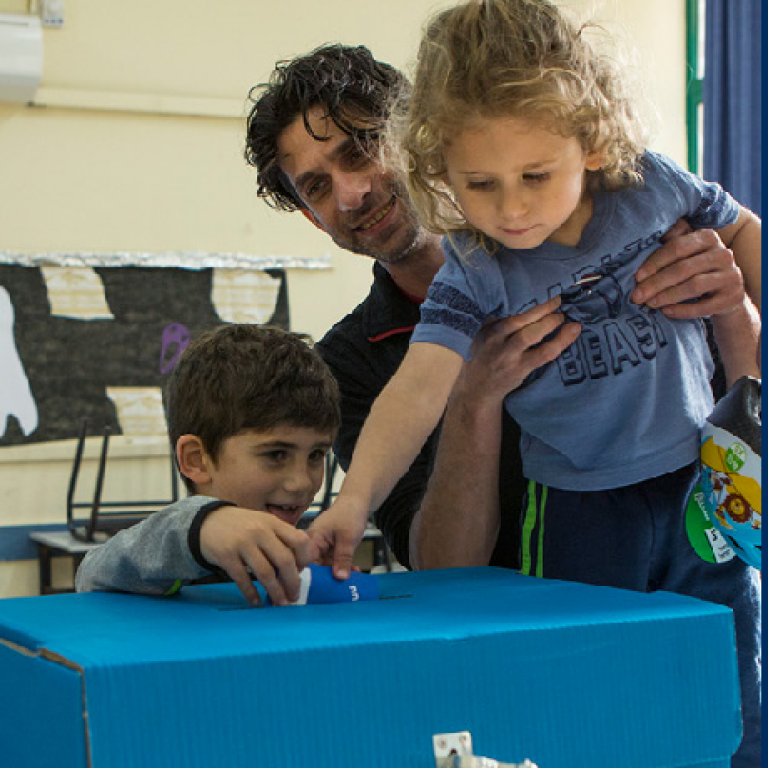 Father and children cast his vote in Israeli election