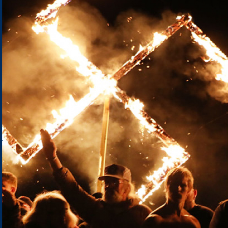 Far-right rally with flaming swastika