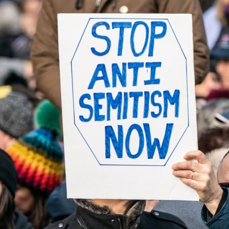 Sign saying stop antisemitism now